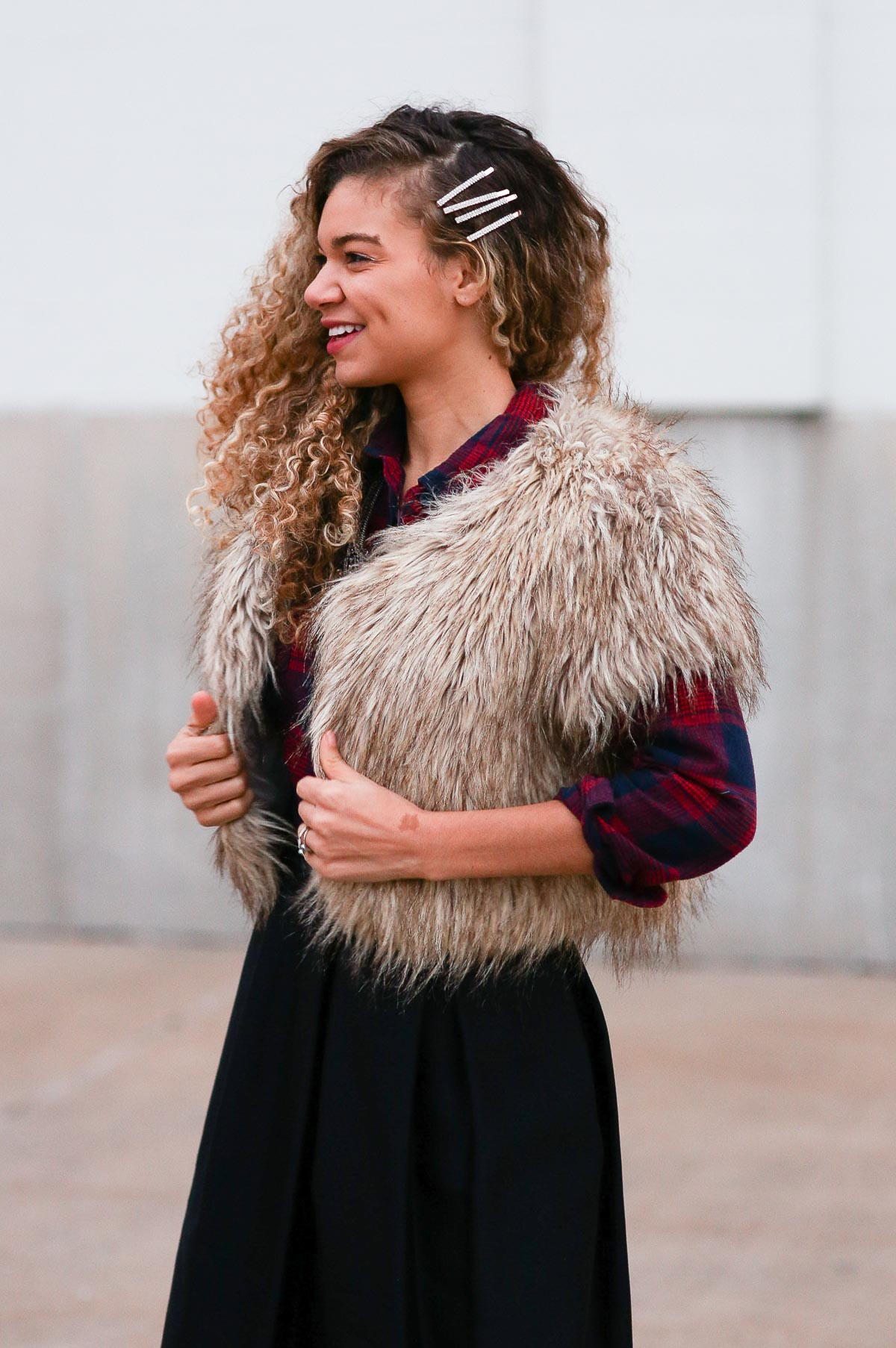 holiday outfits featuring a high waist skirt, plaid shirt, and faux fur