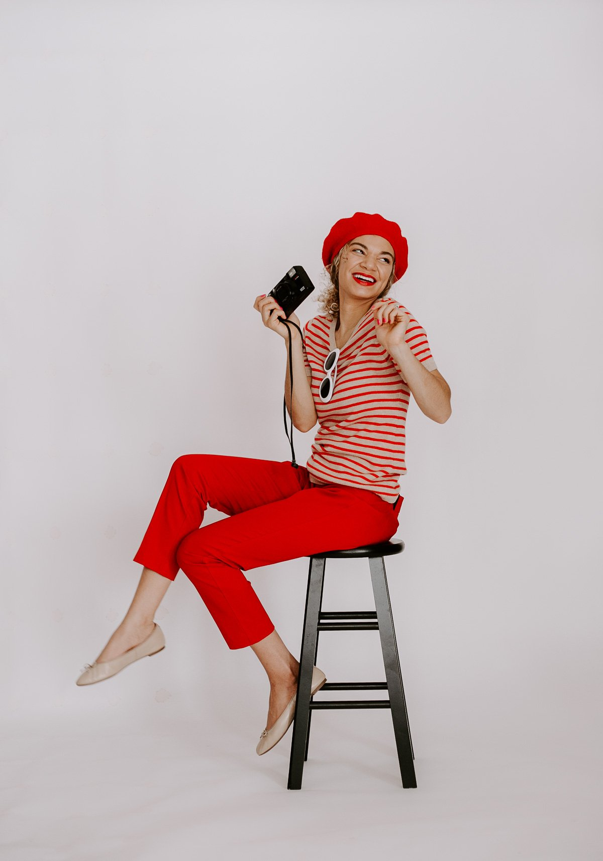 This red Parisian chic outfit with the striped top and beret is what all French style outfit dreams are made of!