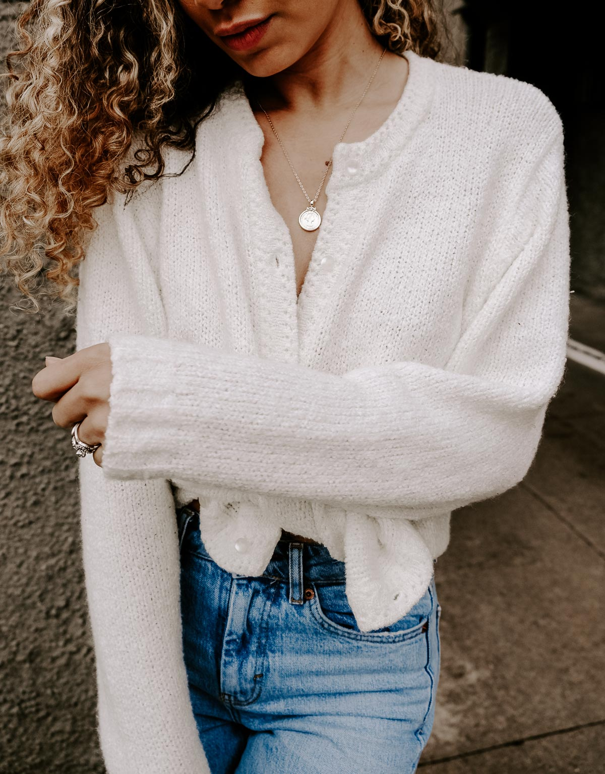 cardigan tied as a top with straight leg jeans