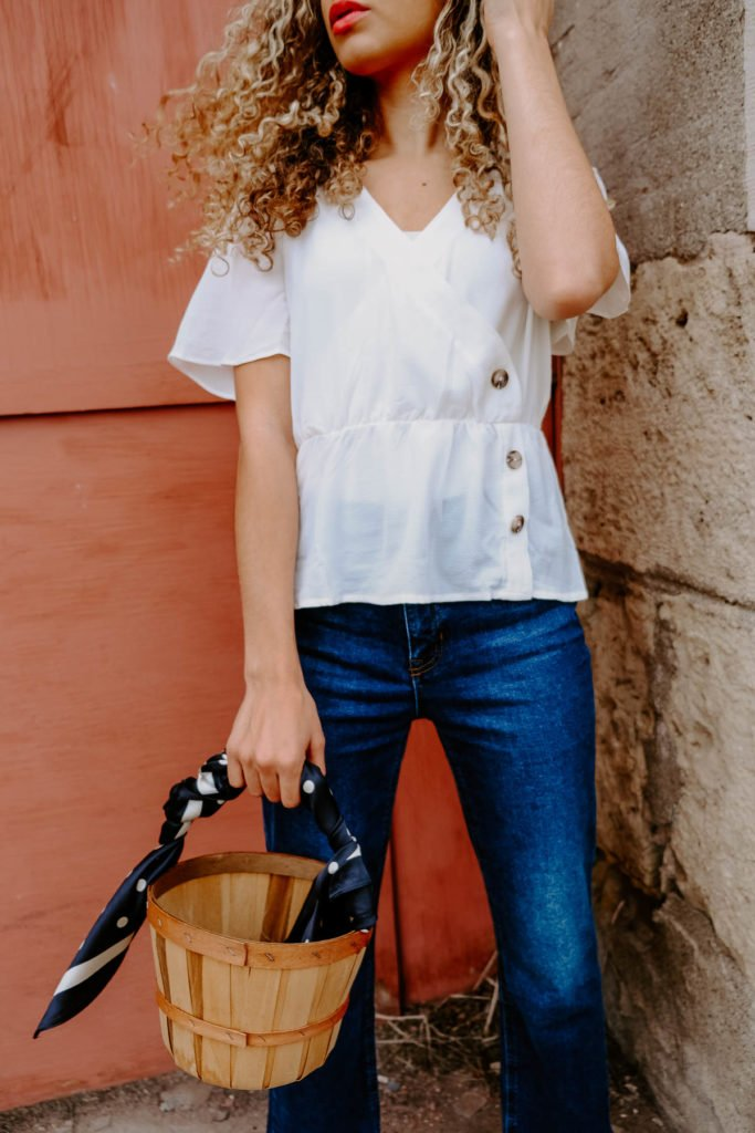 Want to be Parisian chic and dress how the french do? These are the French spring outfit combos that all the girls are wearing right now. All the French style and spring fashion inspo is here! This white blouse with cropped flared jeans and a bucket bag would be a perfect spring and summer outfit go-to.