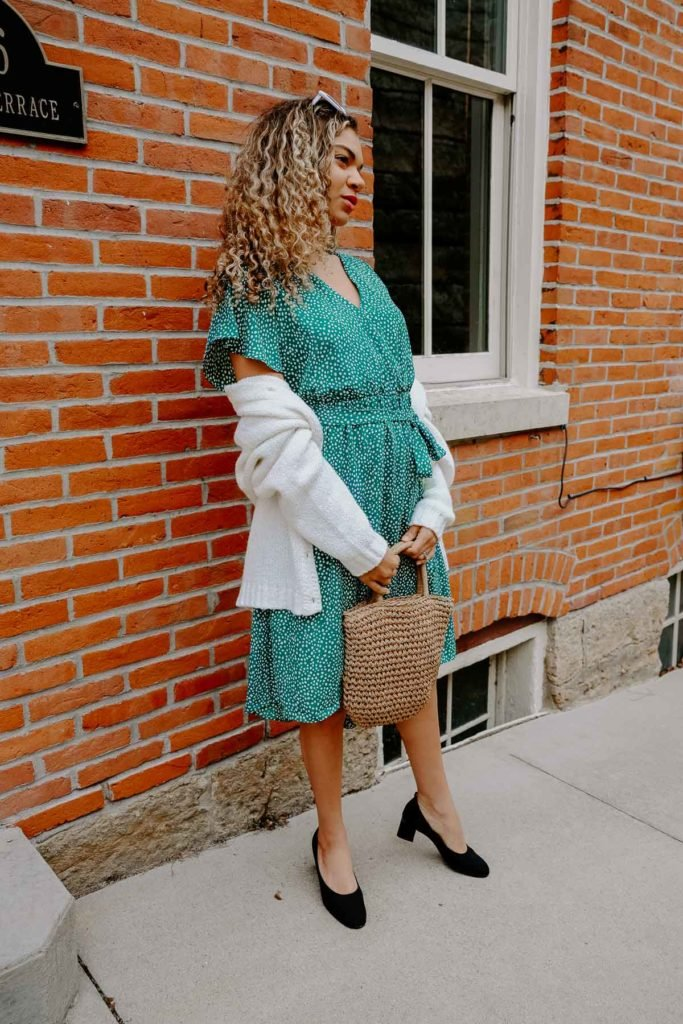 Want to be Parisian chic and dress how the french do? These are the French spring outfit combos that all the girls are wearing right now. All the French style and spring fashion inspo is here! This green wrap dress with block heels and a straw bag is a great spring and summer go to look.