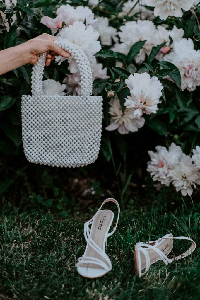 pearl bag and strappy heels
