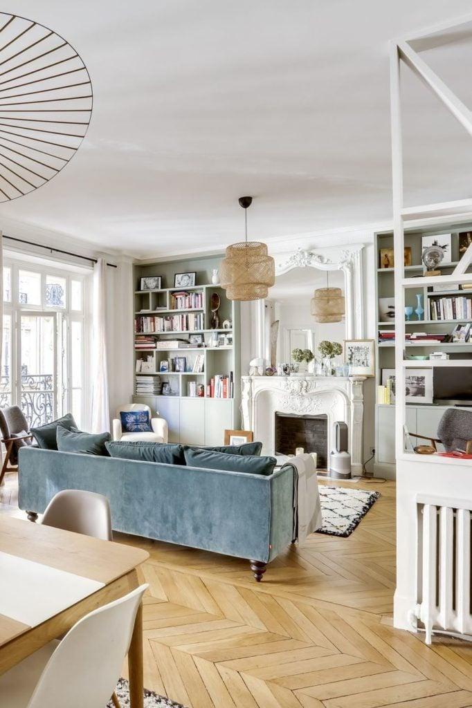 Parisian-Apartment-Decor-Guide-faded-blue-sofa-via-CoteMaison-Studio-85-By-Casaromani-et-Conscience