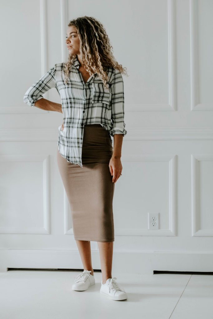 create new outfits from your closet by mixing styles like this plaid shirt and dressy skirt outfit