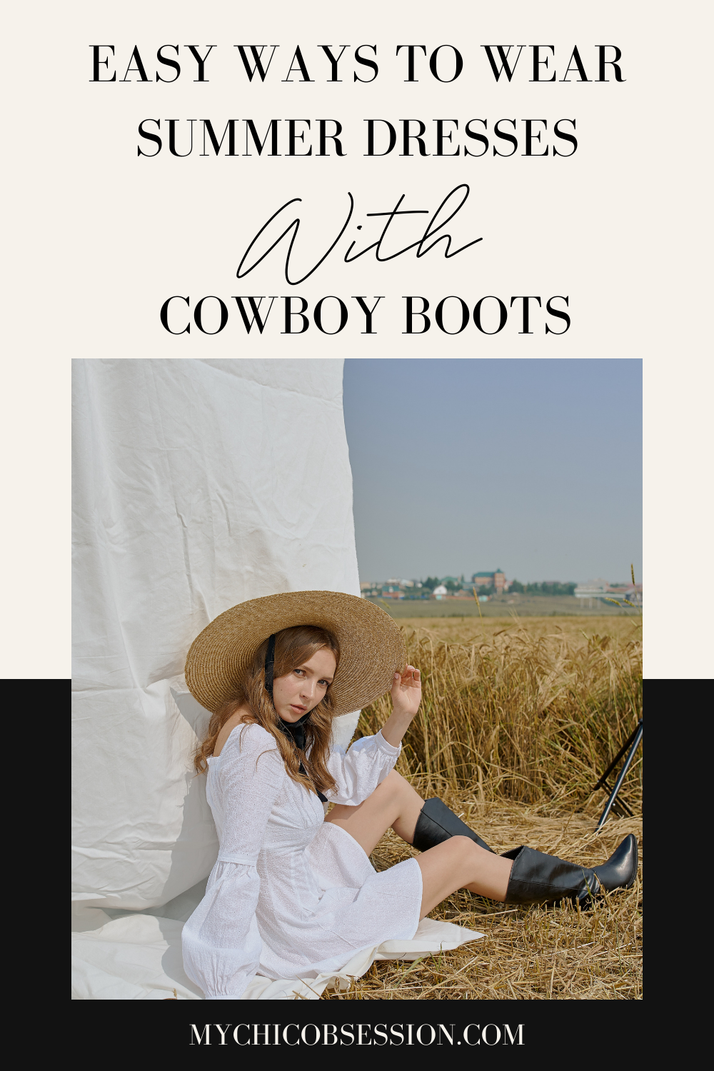 Young white woman sitting in a grass field wearing a white long sleeve dress, thatched wide brim hat and leather cowboy boots
