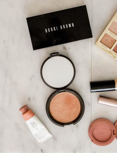 Makeup flat lay of Tarte cosmetics eyeshadow and Bobbi Brown palette