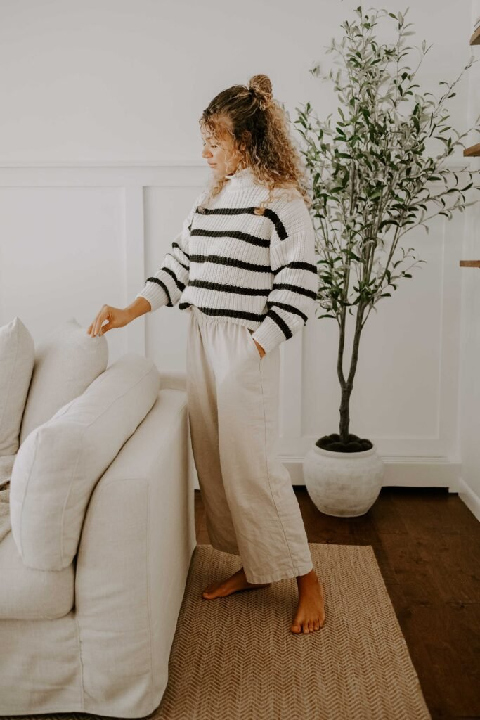 striped sweater and linen pants outfit