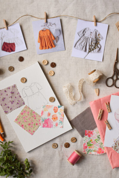 Flatlay-of-sewing-tools-fabric-and-designs.